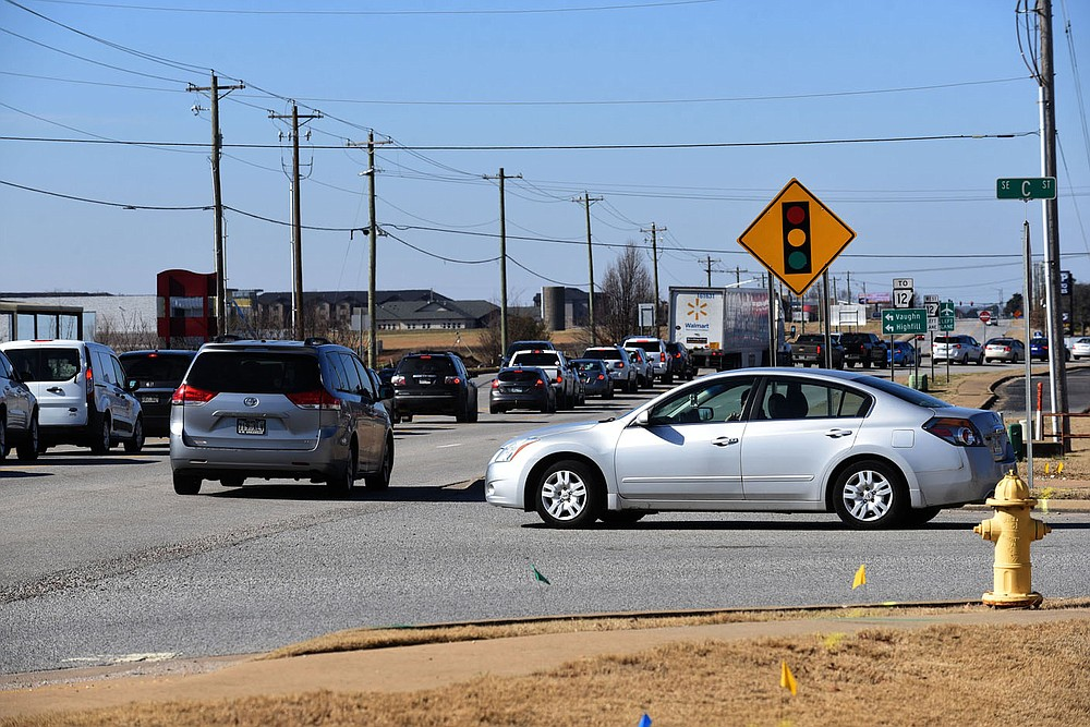 Traffic moves Wednesday Feb. 3 2021 through the intersection of Southeast C and Southeast Walton Boulevard in Bentonville. (NWA Democrat-Gazette/Flip Putthoff)