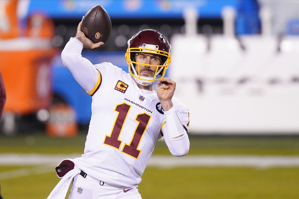 "FILE - Washington Football Team quarterback Alex Smith warms up before an NFL football game against the Philadelphia Eagles in Philadelphia, in this Sunday, Jan. 3, 2021, file photo. Washington's biggest offseason need is to figure out its quarterback situation. Trade for DeShaun Watson? Sign Cam Newton? Roll with Alex Smith and Kyle Allen? Coach Ron Rivera says ""nothing is off the table."" (AP Photo/Chris Szagola, File)"