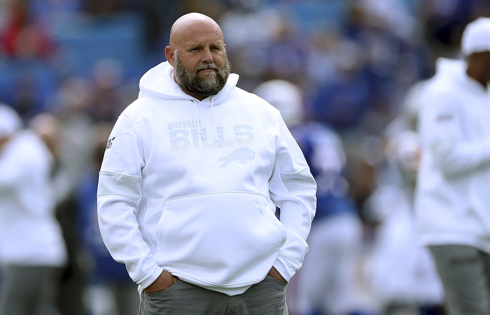FILE - In this Sept. 29, 2019, file photo, Buffalo Bills offensive coordinator Brian Daboll watches the team warm up for an NFL football game against the New England Patriots in Orchard Park, N.Y.    The likelihood of Daboll staying in Buffalo for at least more season have increased after he was passed over in filling the Los Angeles Chargers coaching job, two people with direct knowledge of Daboll's plans told The Associated Press. (AP Photo/Ron Schwane, File)