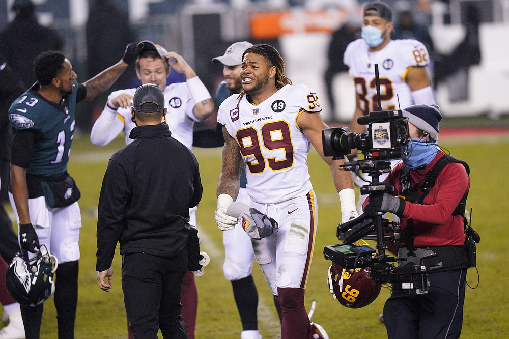 Washington Football Team's Chase Young reacts after an NFL football game against the Philadelphia Eagles, Sunday, Jan. 3, 2021, in Philadelphia. (AP Photo/Chris Szagola)