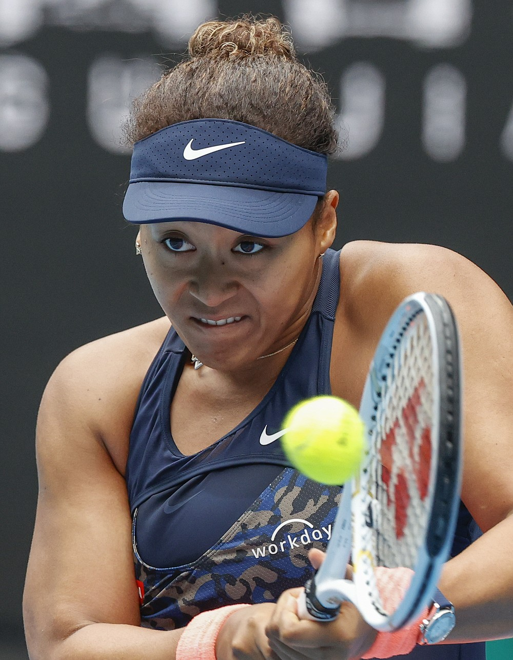 Japan's Naomi Osaka makes a backhand return to Russia's Anastasia Pavlyuchenkova during their first round match at the Australian Open tennis championship in Melbourne, Australia, Monday, Feb. 8, 2021.(AP Photo/Rick Rycroft)