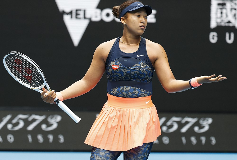 Japan's Naomi Osaka gestures during her match against Russia's Anastasia Pavlyuchenkova at the Australian Open tennis championship in Melbourne, Australia, Monday, Feb. 8, 2021.(AP Photo/Rick Rycroft)