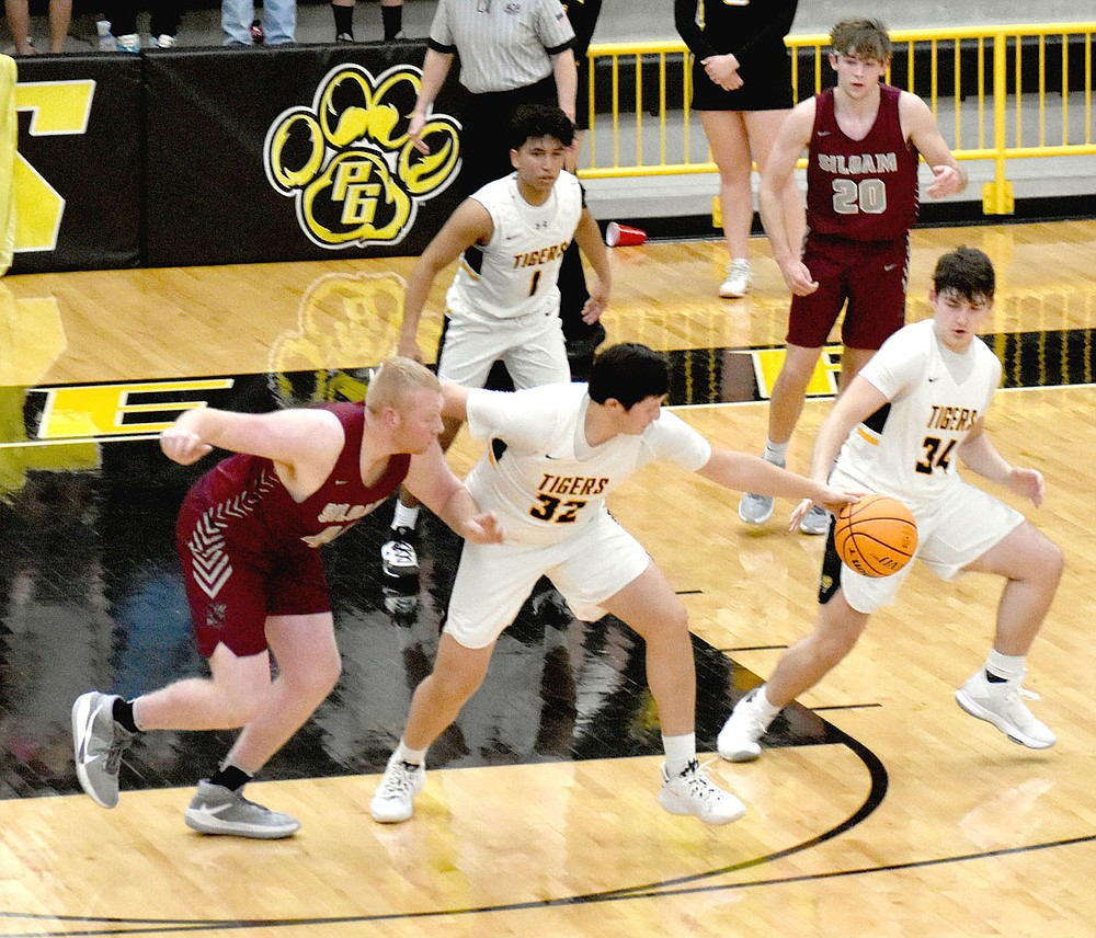 MARK HUMPHREY  ENTERPRISE-LEADER/Prairie Grove's Ethan Gross steals the ball while defending the high post.