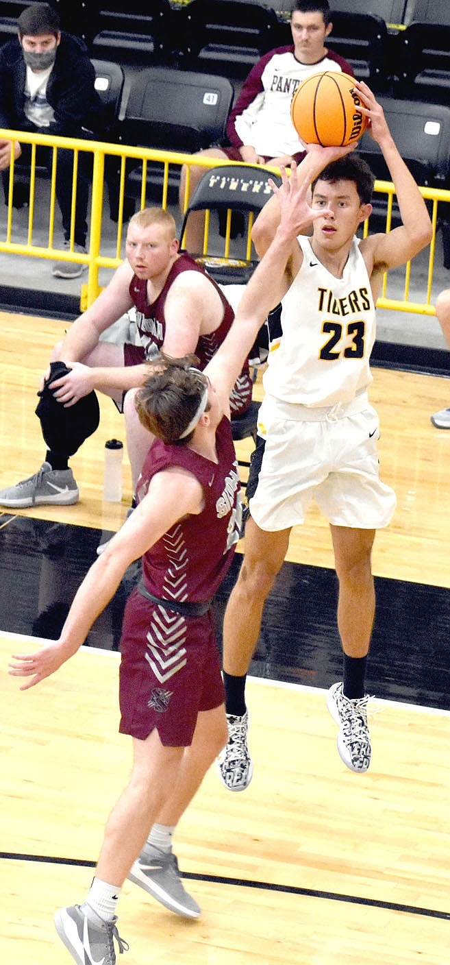 MARK HUMPHREY  ENTERPRISE-LEADER/Prairie Grove senior Sloan Smith elevates while launching a jump-shot from the corner in 3-point territory.
