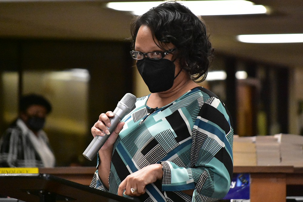 Kristy Sanders, district K-12 curriculum director for the Watson Chapel School District, gives a report on the Ready for Learning Committee and District Guidance Coalition Team during the school board meeting held Monday. (Pine Bluff Commercial/I.C. Murrell)