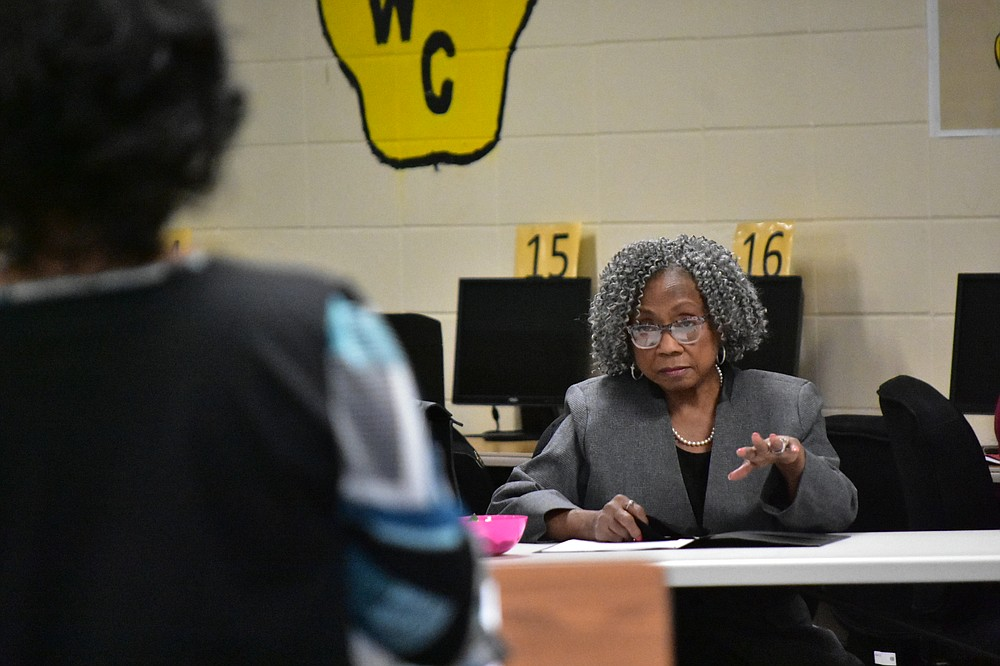 Watson Chapel School District board member Sandra Boone (right) directs a question to K-12 curriculum director Kristy Sanders during Monday's school board meeting. (Pine Bluff Commercial/I.C. Murrell)