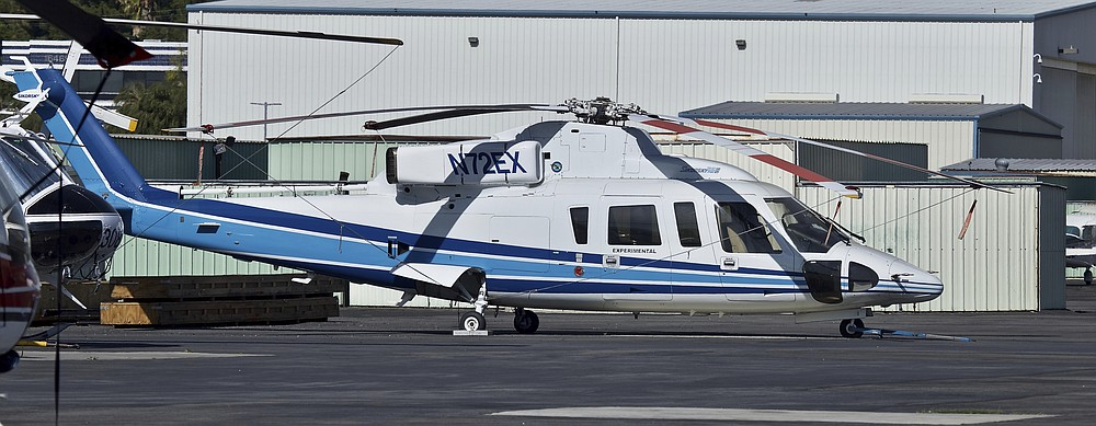 FILE - In this Feb. 1, 2018, file photo shows a Sikorsky S-76B helicopter (N72EX) at Van Nuys Airport in Van Nuys, Calif. NBA legend Kobe Bryant, his 13-year-old daughter and several others were riding in the helicopter when it crashed Jan. 26, 2020, in Calabasas, Calif. Federal safety officials are expected to vote Tuesday, Feb. 9, 2021, on what likely caused the helicopter carrying Kobe Bryant, his 13-year-old daughter and seven others to crash into a Southern California hillside last year, killing all aboard. (AP Photo/Matt Hartman, File)