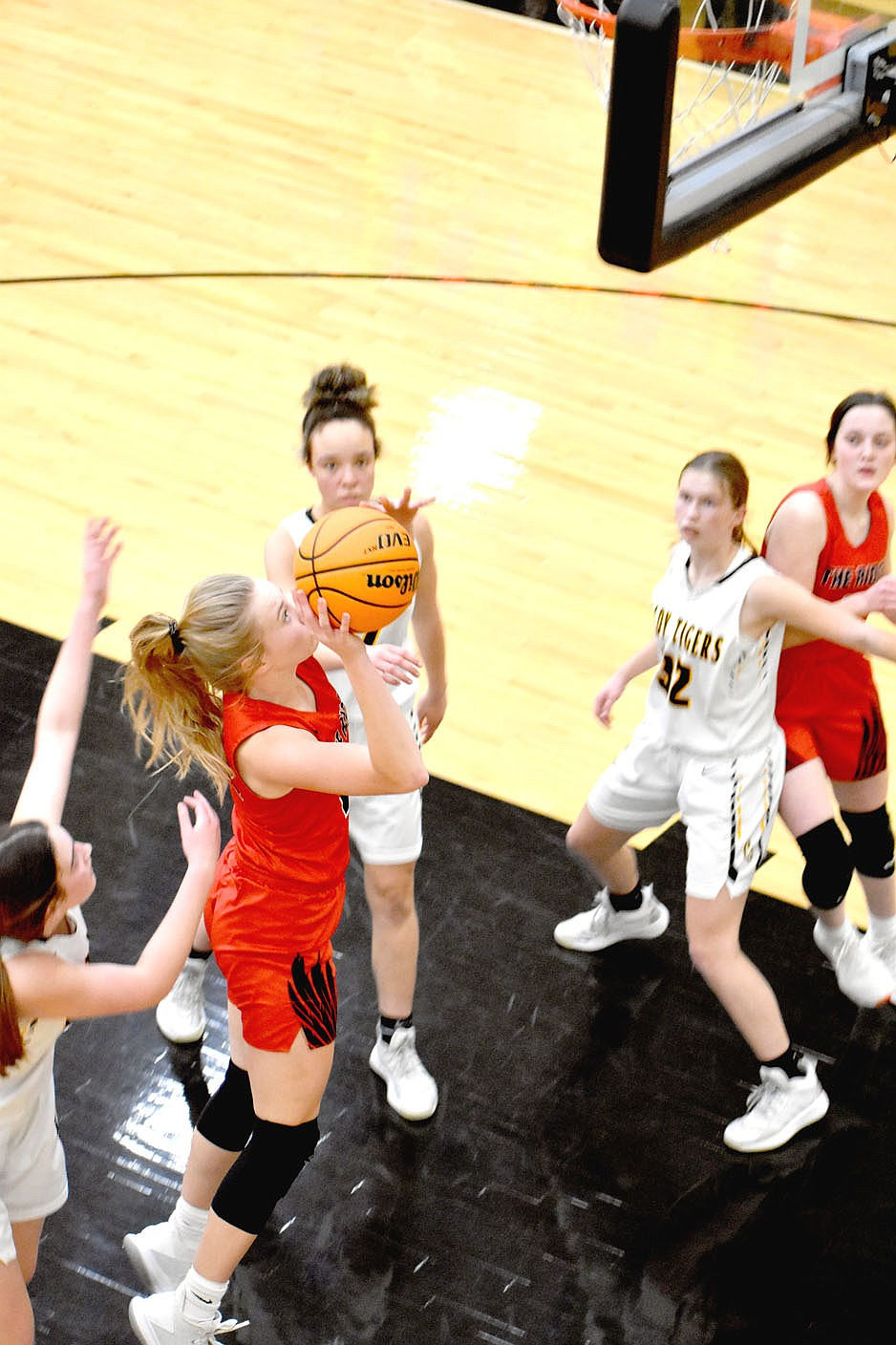 MARK HUMPHREY  ENTERPRISE-LEADER/Pea Ridge junior Lauren Wright finishes a drive by scoring in the lane against Prairie Grove. Wright scored 5 points in the Lady Blackhawks' 65-38 win in 4A-1 Conference girls basketball action at Tiger Arena on Tuesday, Feb. 9.