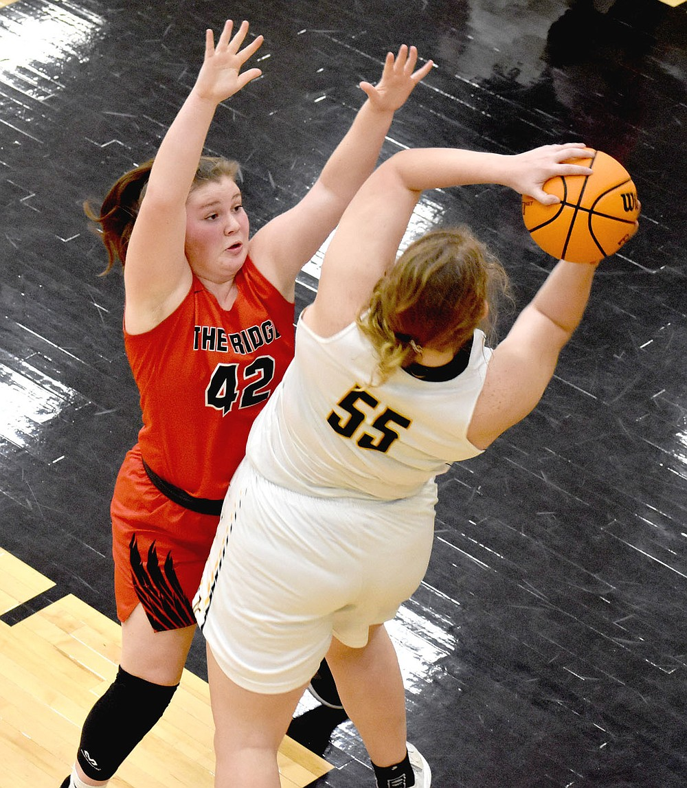 MARK HUMPHREY  ENTERPRISE-LEADER/Pea Ridge senior Hayley West contests an outlet pass after Prairie Grove 6-0 senior Olivia Kestner controlled a defensive rebound. West scored 8 points in the Lady Blackhawks' 65-38 win in 4A-1 Conference girls basketball action at Tiger Arena on Tuesday, Feb. 9.