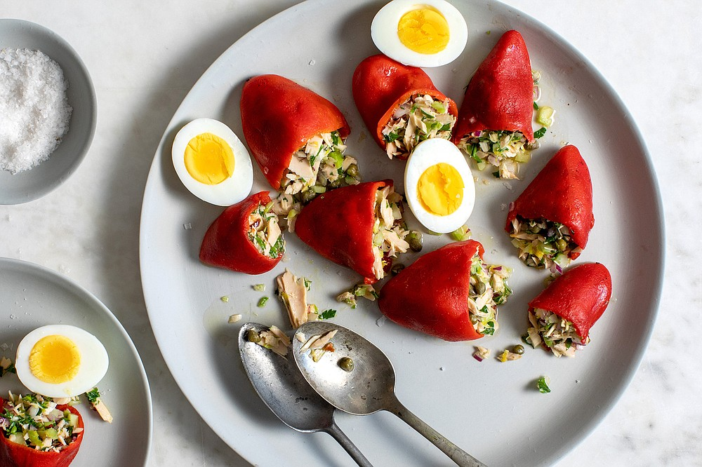 A few of these Tuna-Stuffed Piquillo Peppers make a zesty first course, served with crisp lettuce leaves and hard-cooked egg. (The New York Times/Andrew Scrivani)
