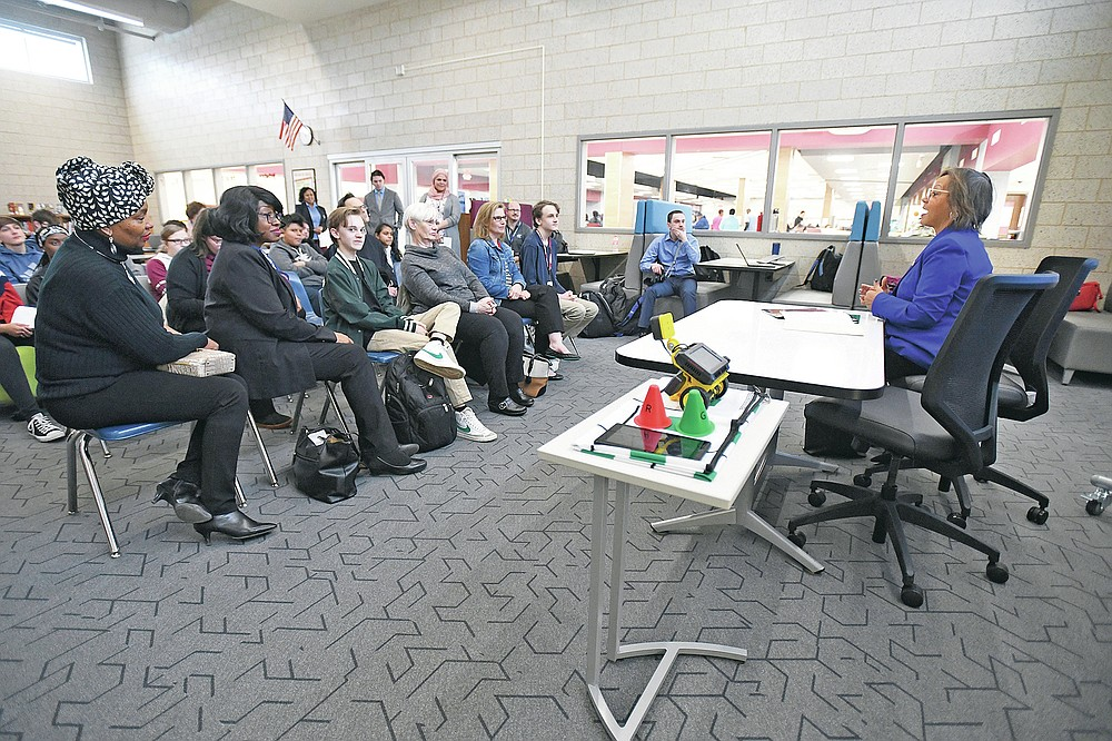 U.S. Rep. Robin Kelly visits Kankakee High School to recognize freshman David Love, at center in front row with his family, on his project that won the 2019 Congressional App Challenge for Illinois' 2nd Congressional District, Monday, Feb. 24, 2020 in Kankakee, Ill. (Tiffany Blanchette/The Daily Journal via AP)
