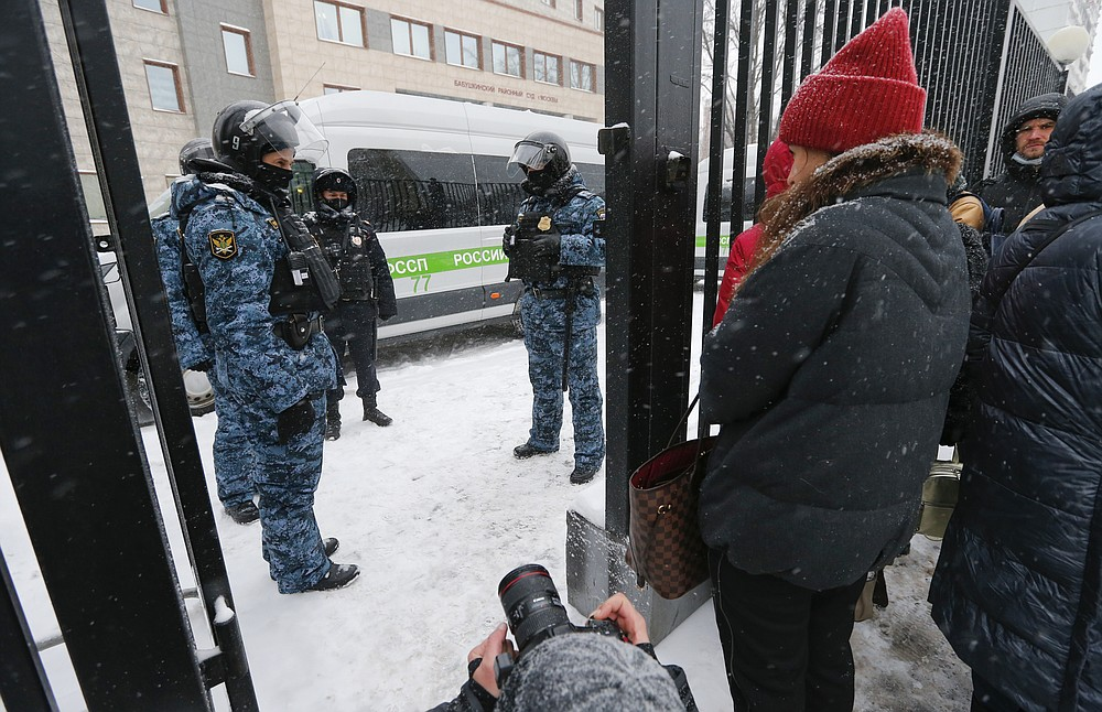 """Police officers stand guard at the Babuskinsky district court prior to the start of the trial against Russian opposition leader Alexey Navalny in Moscow, Russia, Friday, Feb. 12, 2021. Navalny was accused of slandering a World War II veteran featured in the video promoting the constitutional reform allowing to extend President Vladimir Putin's rule. The politician slammed people in the video as """"corrupt stooges"""" and """"traitors."""" (AP Photo/Alexander Zemlianichenko)"""