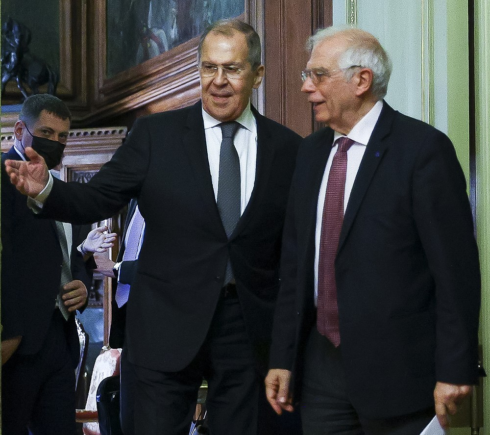 """In this photo released by the Russian Foreign Ministry Press Service, Russian Foreign Minister Sergey Lavrov, left, welcomes High Representative of the EU for Foreign Affairs and Security Policy, Josep Borrell to attend a joint news conference following their talks in Moscow, Russia, Friday, Feb. 5, 2021. The European Union's top diplomat expressed hopes Friday that the COVID-19 vaccine developed by Russia will soon be used across the 27-nation bloc. During a visit to Moscow, EU foreign affairs chief Josep Borrell said the Sputnik V vaccine is """"good news for the whole mankind."""" (Russian Foreign Ministry Press Service via AP)"""