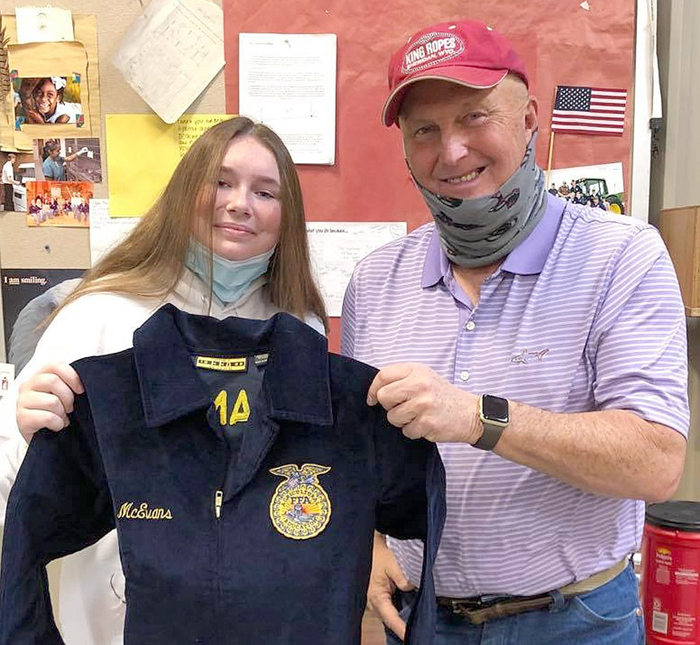 McEvans received her jacket from teacher Perry Mason.