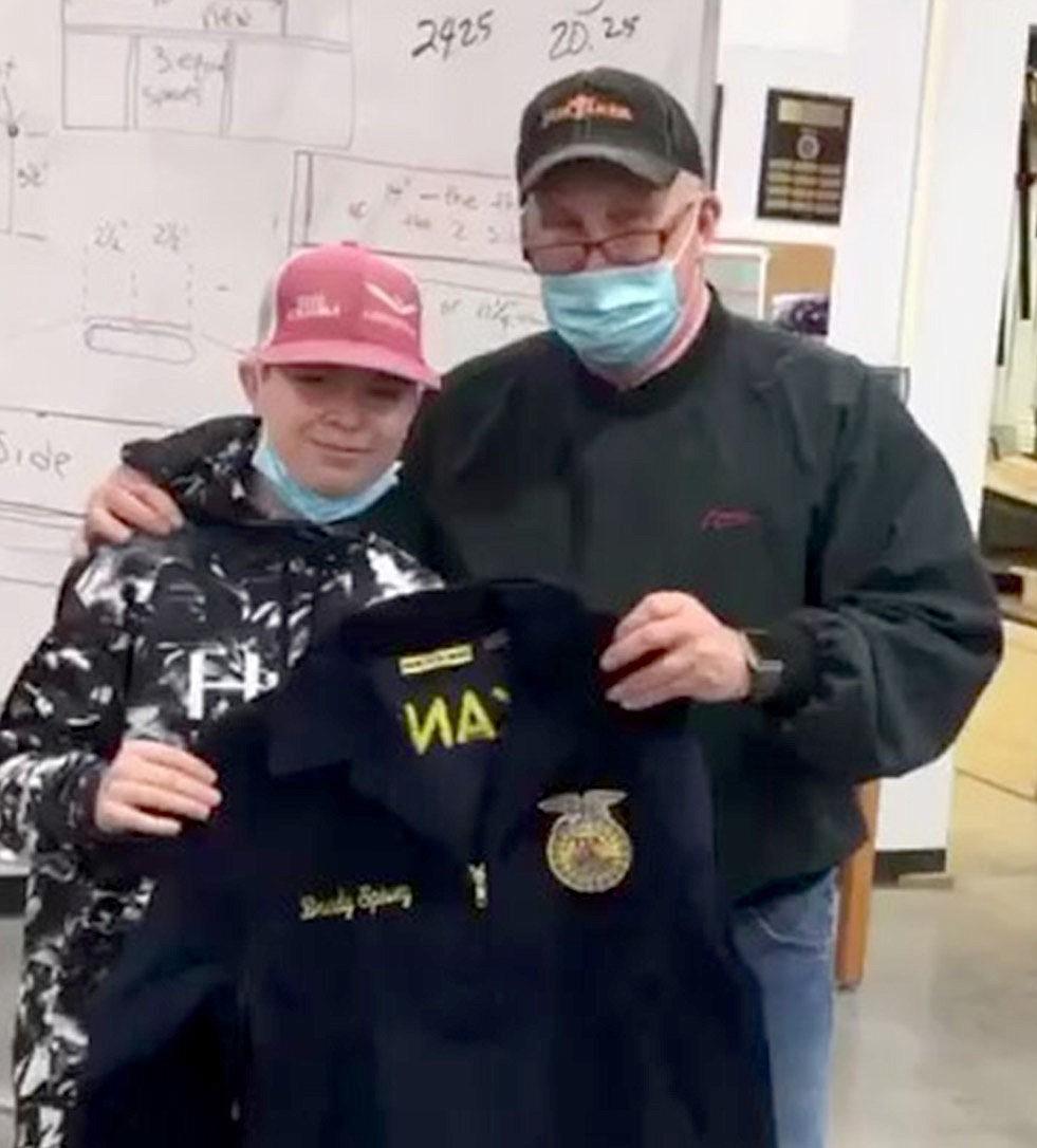 Brady Spivey was presented his FFA jacket by teacher Perry Mason.