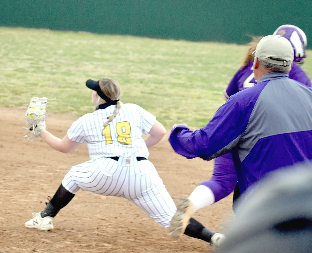 MARK HUMPHREY  ENTERPRISE-LEADER/Berryville softball coach Josh Hatfield (right) reacts, realizing Prairie Grove senior Madison Hutchinson has the ball in glove with a foot on the bag to record a force out to end the Lady Bobcats' last at-bat and prevent them from increasing a 5-2 lead. The out involved three Lady Tigers, Sydney Stearman, who dove stopping the ball; Makinsey Parnell, who made the throw; and Hutchinson. Prairie Grove followed up the outstanding defense with offense producing 4 runs in the bottom of the seventh to win 6-5.