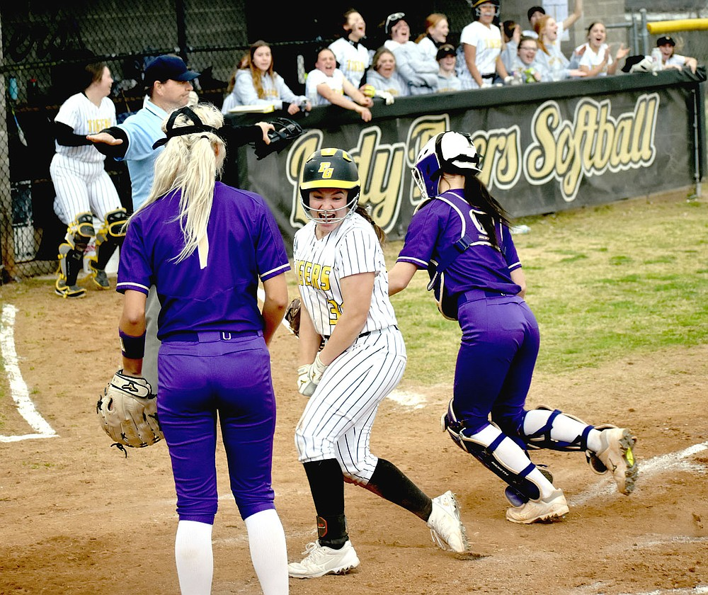 MARK HUMPHREY  ENTERPRISE-LEADER/Prairie Grove senior Makinsey Parnell breaks into a jubilant smile, realizing she just scored the winning run on Kelsey Pickett's double, capping a furious Lady Tiger 4-run rally in the bottom of the seventh to open 4A-1 Conference softball play with a 6-5 win over Berryville on Tuesday, March 30.