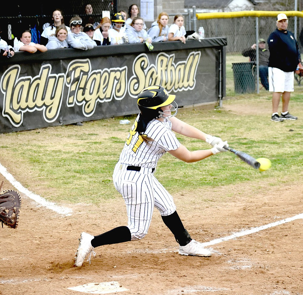 MARK HUMPHREY  ENTERPRISE-LEADER/Prairie Grove senior Makinsey Parnell drove a single into the outfield, which she turned into a double on a throw home that gunned down classmate Sydney Stearman at the plate for the second out with the game tied 5-5. Parnell scored the winning run coming from second with Kelsey Pickett smacking a double to drive her in.