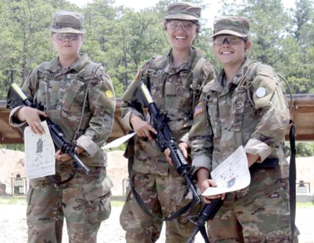Photo submitted Siloam Springs senior basketball player Mia Hevener, right, seen here last summer at Army National Guard basic training in Fort Jackson, South Carolina.