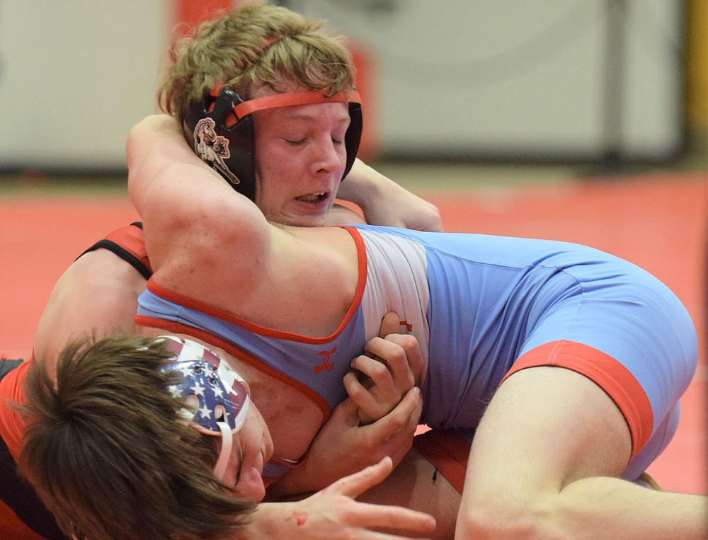 RICK PECK/SPECIAL TO MCDONALD COUNTY PRESS McDonald County's Levi Smith pinned Dominic Boles of Webb City in the semifinals of the district tournament only to lose later in the championship match.