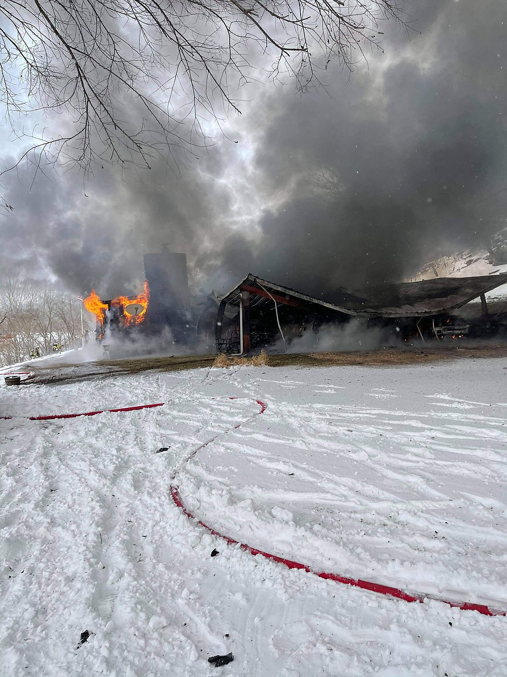 Courtesy photo/Special to the McDonald County Press A house that caught fire on Little Missouri Hollow on Monday afternoon has been deemed a total loss, said White Rock Fire Department Chief Jason Bowman. Cause of fire could not be determined because the structure was too destroyed, he said.