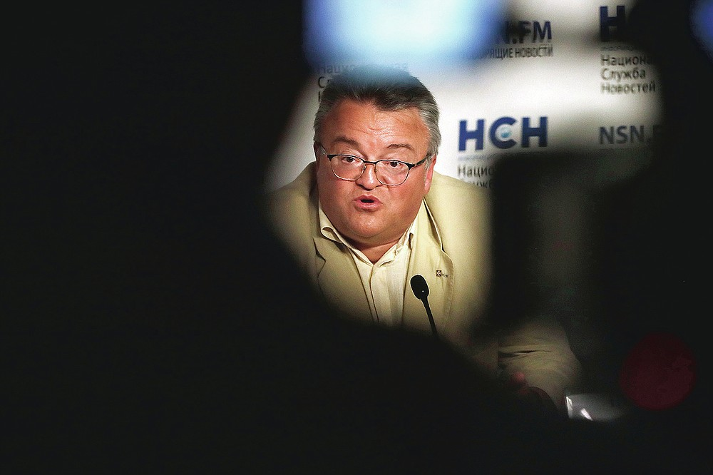 FILE - In this Sept. 4, 2020 file photo, former military expert Igor Nikulin speaks during a news conference in Moscow, Russia. Nikulin argues the U.S. created the virus and used it to attack China. (AP Photo/Pavel Golovkin, File)