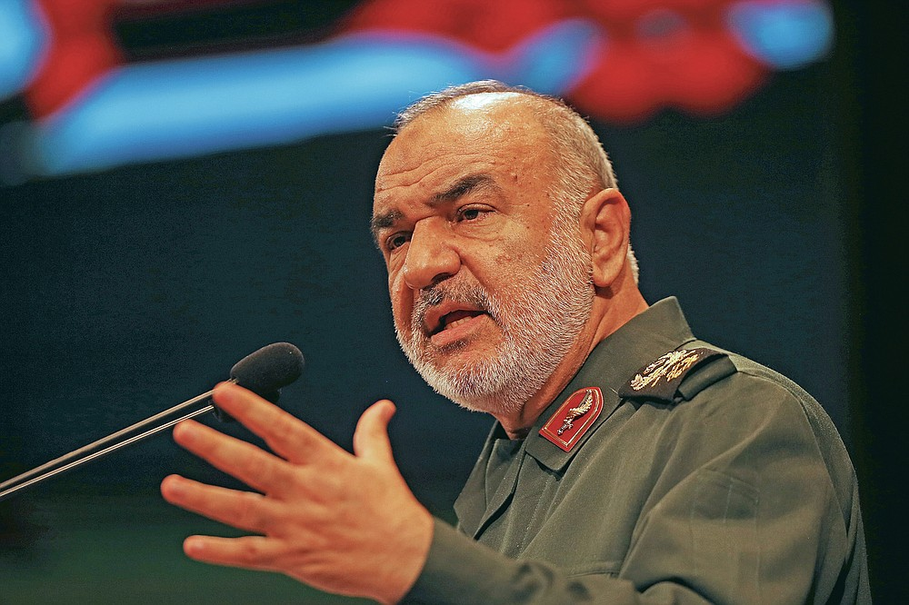 FILE - In this Nov. 22, 2018 file photo, the then-deputy commander of Iran's Revolutionary Guard Gen. Hossein Salami speaks during a conference in Tehran, Iran. Salami declared on March 5, 2020 that Iran is currently engaged in a fight against a virus which might be the product of an American biological attack. (AP Photo/Vahid Salemi, File)