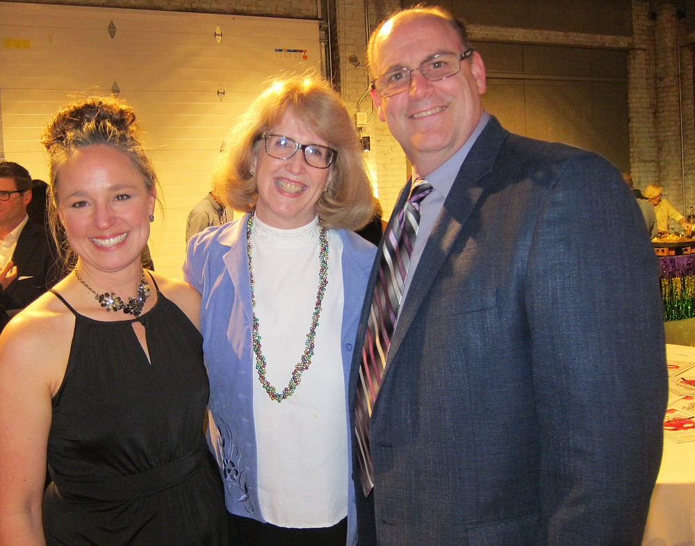 NWA Democrat-Gazette/CARIN SCHOPPMEYER Kassie Misiewicz, Trike founder and artistic director, visits with Florence and Scott Galbraith at Laughter and Libations.