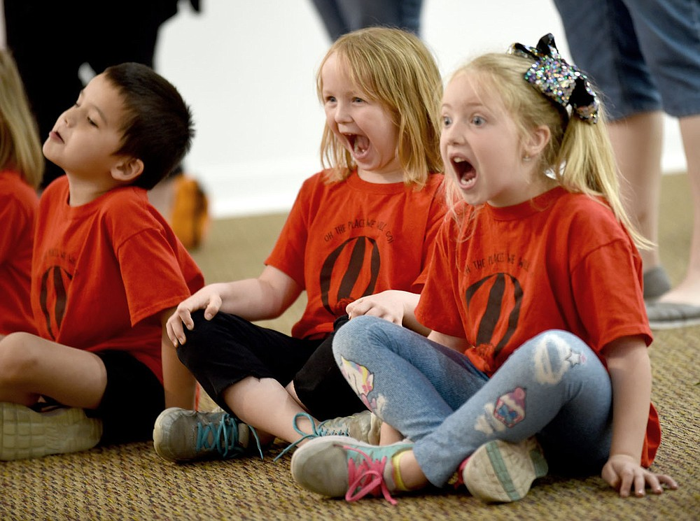 NWA Democrat-Gazette/DAVID GOTTSCHALK   From left, Ember Crawley and Tess Cravens, kindergarten students from Glenn Duffy Elementary School in Gravette, participate Wednesday, April 10, 2019, in an Act it Out pre-show experience at the Arts Center of the Ozarks in Springdale. The students were at the center to see Balloonacy, part of the Little Trike Series, at the center. The performance continues today through Saturday.
