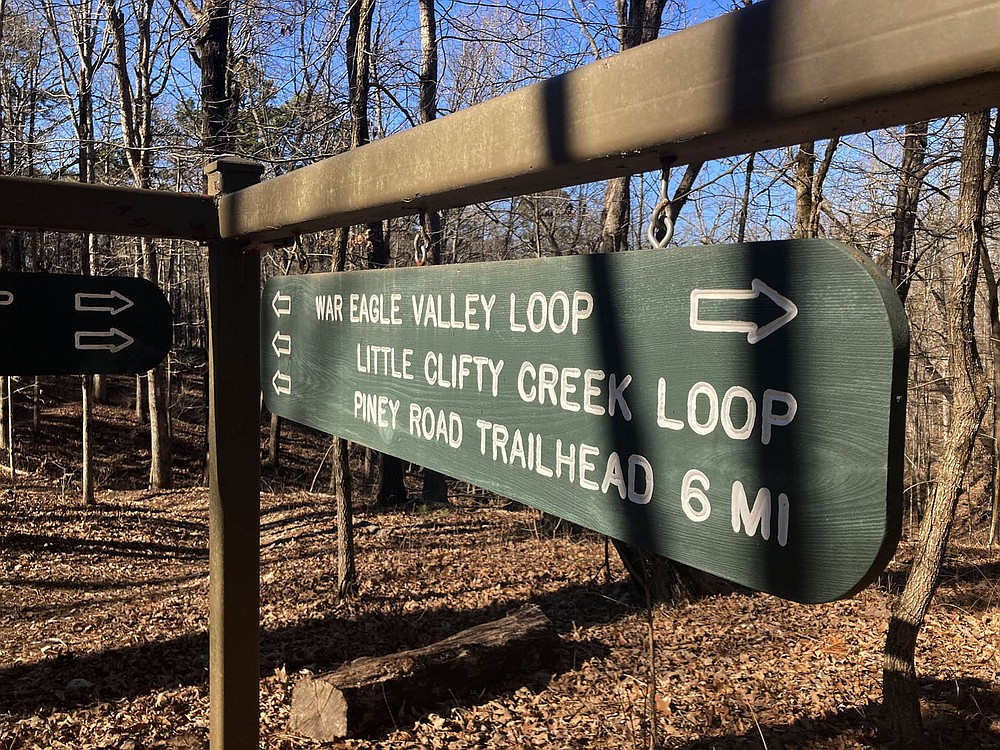Signs at trail intersections help hikers, mountain bikes and horeseback riders follow the War Eagle Valley Loop. (NWA Democrat-Gazette/Flip Putthoff)
