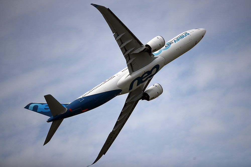 FILE - In this June 18, 2019 file photo, an Airbus A330 performs a demonstration flight at Paris Air Show, in Le Bourget, north east of Paris. European plane maker Airbus lost 1.1 billion euros ($1.3 billion) amid an unprecedented global slump in air travel because of the pandemic, but expects to deliver hundreds of planes and make a profit this year. (AP Photo/ Francois Mori, File)