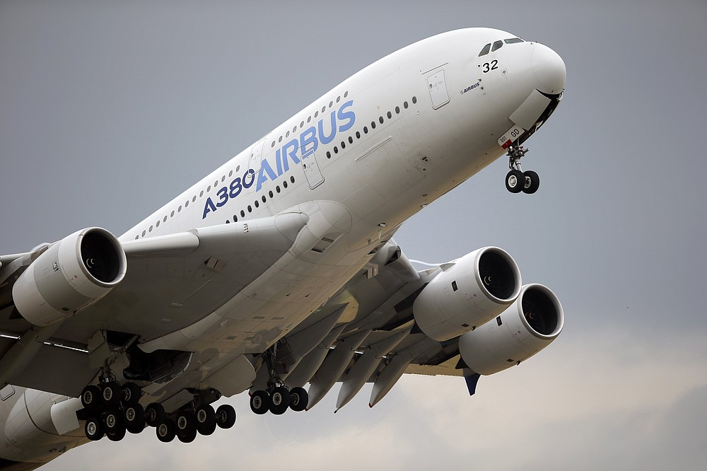 FILE - In this June 18, 2015, file photo, an Airbus A380 takes off for its demonstration flight at the Paris Air Show in Le Bourget airport, north of Paris. European plane maker Airbus lost 1.1 billion euros ($1.3 billion) amid an unprecedented global slump in air travel because of the pandemic, but expects to deliver hundreds of planes and make a profit this year. (AP Photo/Francois Mori, File)