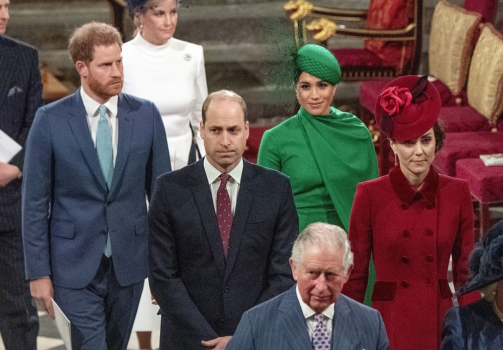 FILE - In this file photo dated Monday March 9, 2020, from back, Britain's Prince Harry and Meghan Duchess of Sussex, Prince William and Kate, Duchess of Cambridge, with Prince Charles, front, as the family members leave the annual Commonwealth Service at Westminster Abbey in London.  Harry and Meghan stepped away from full-time royal life early 2020, and Buckingham Palace on Friday Feb. 19, 2021, confirmed the couple will not be returning to royal duties, and Harry will give up his honorary military titles.(Phil Harris / Pool FILE via AP)