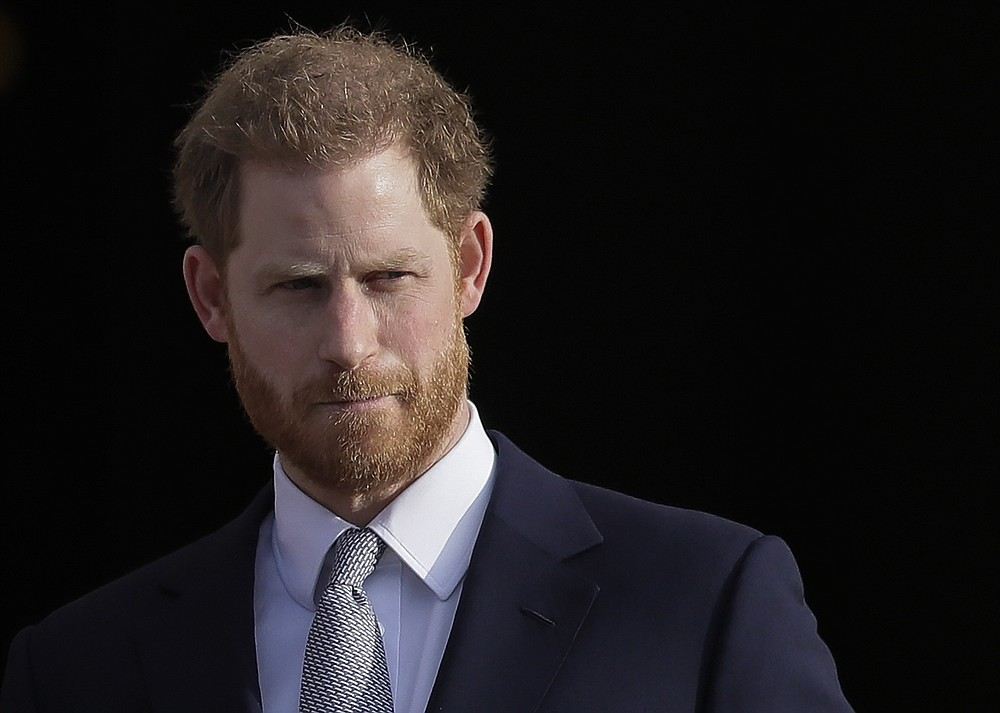 FILE - In this Thursday, Jan. 16, 2020, file photo, Britain's Prince Harry arrives in the gardens of Buckingham Palace in London.  Prince Harry and Meghan stepped away from full-time royal life in 2020, and Buckingham Palace on Friday Feb. 19, 2021, confirmed the couple will not be returning to official royal duties, and Harry will give up his honorary military titles. (AP Photo/Kirsty Wigglesworth, File)