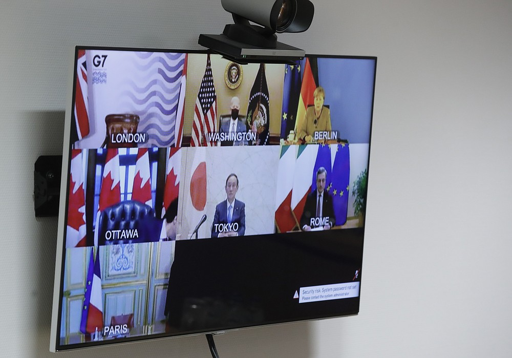 A general view of the video screen of G7 leaders as European Commission President Ursula von der Leyen and European Council President Charles Michel prepare to take part online at the European Council building in Brussels, Friday, Feb. 19, 2021. (Olivier Hoslet, Pool via AP)