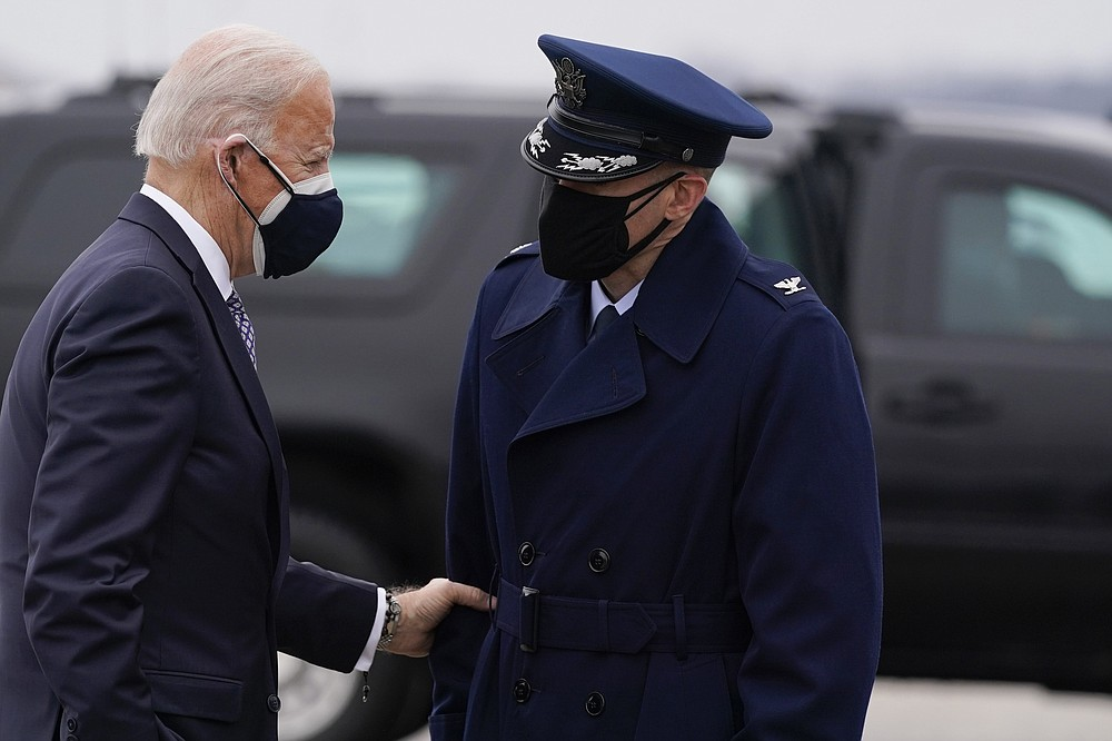 President Joe Biden speaks to someone as he arrives to board Air Force One for a trip to Kalamazoo, Mich., to visit a Pfizer plant, Friday, Feb. 19, 2021, in Andrews Air Force Base, Md. (AP Photo/Evan Vucci)