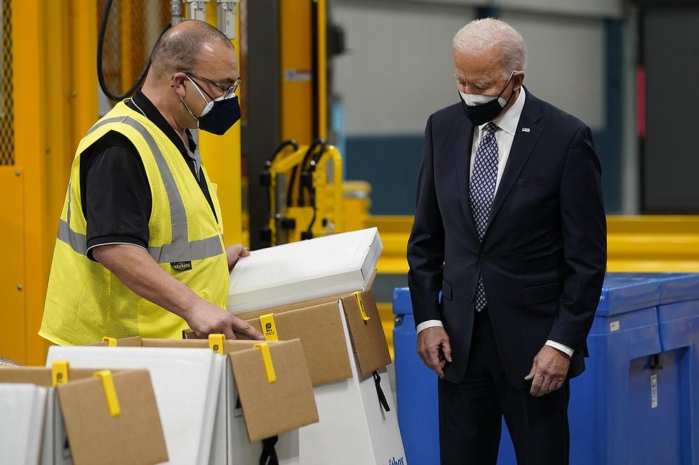President Joe Biden tours a Pfizer manufacturing site, Friday, Feb. 19, 2021, in Portage, Mich. (AP Photo/Evan Vucci)