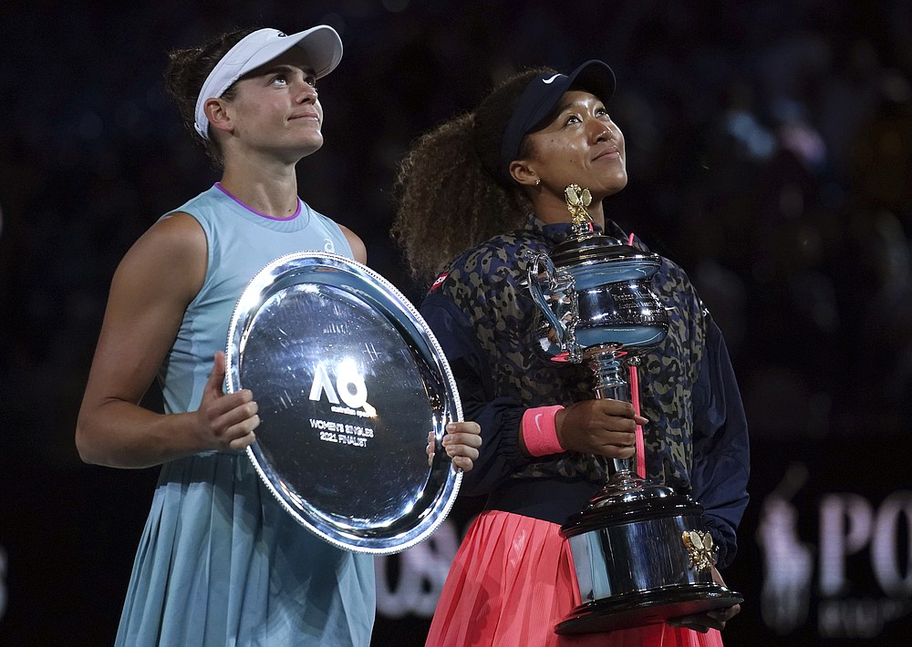 Japan's Naomi Osaka, right, holds the Daphne Akhurst Memorial Cup after defeating United States Jennifer Brady, left, in the women's singles final at the Australian Open tennis championship in Melbourne, Australia, Saturday, Feb. 20, 2021.(AP Photo/Mark Dadswell)