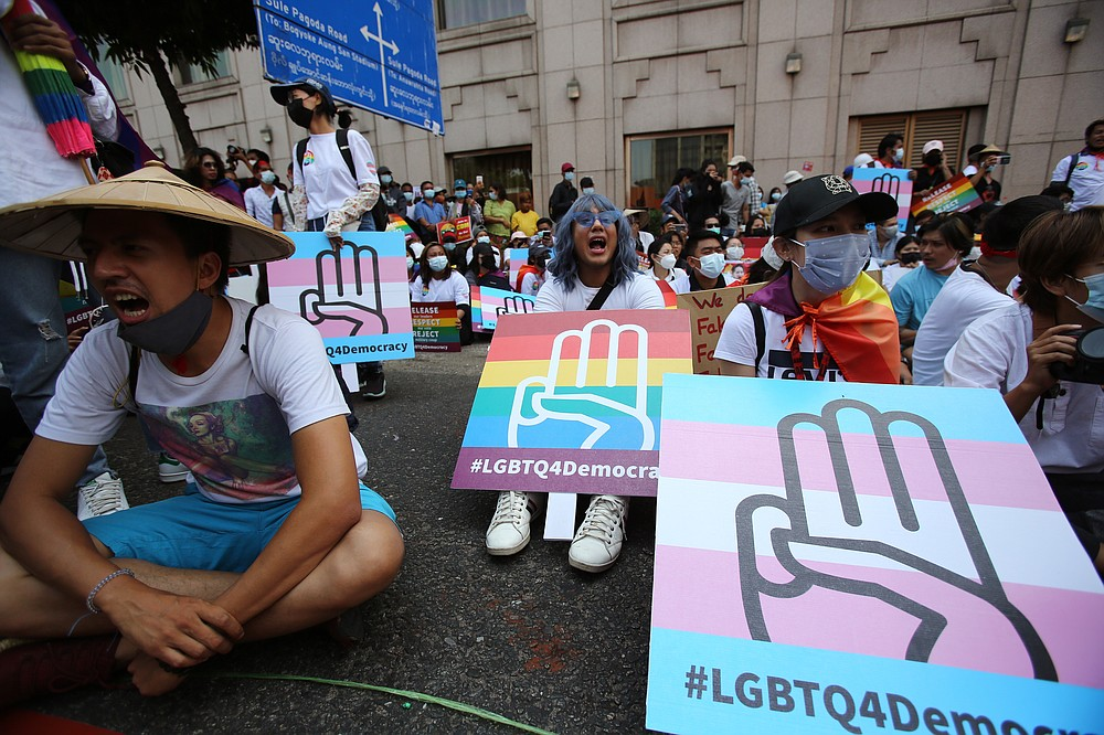 Anti-coup protesters from the LGBTQ community attend a rally in downtown Yangon, Myanmar Friday, Feb. 19, 2021. A young woman who was shot in the head by police during a protest last week against the military's takeover of power in Myanmar died Friday morning, her brother said.(AP Photo)