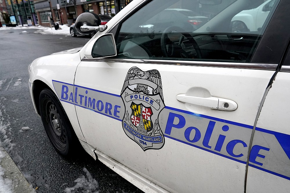 A Baltimore police cruiser is seen parked, Thursday, Feb. 18, 2021, in Baltimore. A package of police reforms in Maryland this year prompted by the death of George Floyd includes a proposed repeal of the Law Enforcement Officers Bill of Rights, the first-in-the-nation law implemented in 1974 that has been replicated in other states. (AP Photo/Julio Cortez)