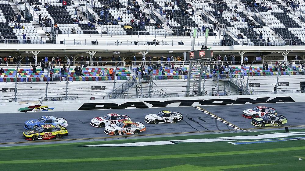 Brett Moffitt (02) and Austin Cindric (22) lead the field to start the NASCAR Xfinity Series road course auto race at Daytona International Speedway, Saturday, Feb. 20, 2021, in Daytona Beach, Fla. (AP Photo/John Raoux)