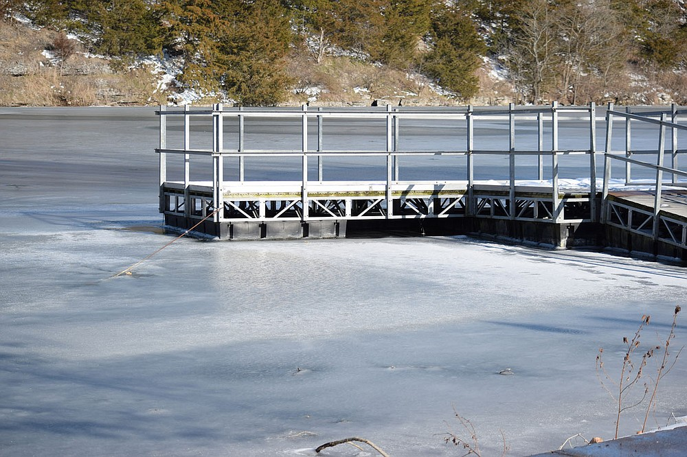 Westside Eagle Observer/MIKE ECKELS The boat dock at Crystal Lake is surrounded by ice left over from an extremely dangerous Arctic air mass that encompasses over half of the United State for over 10 days. Warmer weather Feb. 20 started to thaw the snow and ice on the lake, creating dangerous conditions for anyone who tries to walk on the thinning ice.