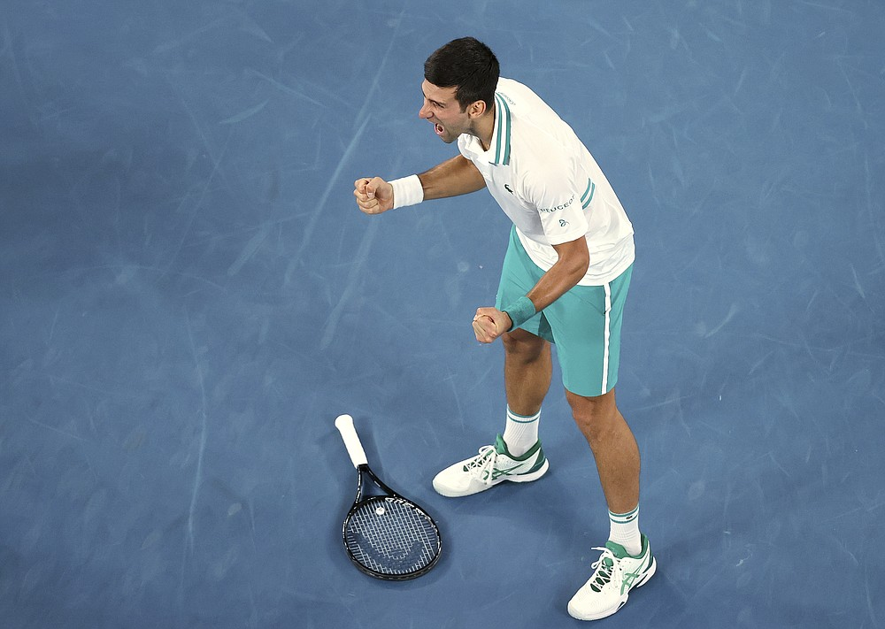 Serbia's Novak Djokovic celebrates after defeating Russia's Daniil Medvedev in the men's singles final at the Australian Open tennis championship in Melbourne, Australia, Sunday, Feb. 21, 2021. (AP Photo/Hamish Blair)
