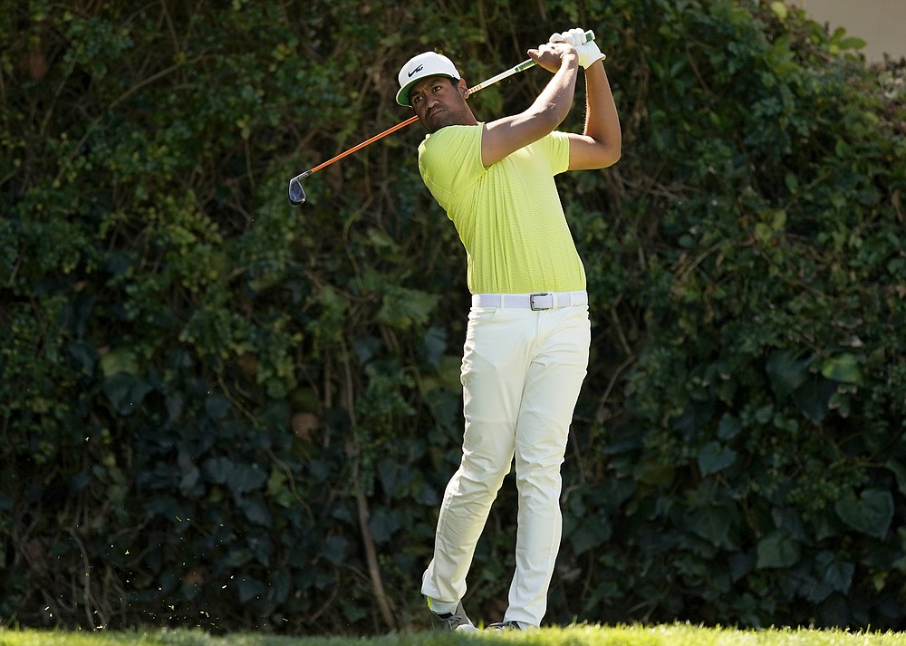 Tony Finau tees off on the seventh hole during the final round of the Genesis Invitational golf tournament at Riviera Country Club, Sunday, Feb. 21, 2021, in the Pacific Palisades area of Los Angeles. (AP Photo/Ryan Kang)