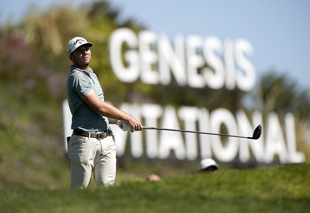 Sam Burns watches his tee shot on the third hole during the final round of the Genesis Invitational golf tournament at Riviera Country Club, Sunday, Feb. 21, 2021, in the Pacific Palisades area of Los Angeles. (AP Photo/Ryan Kang)