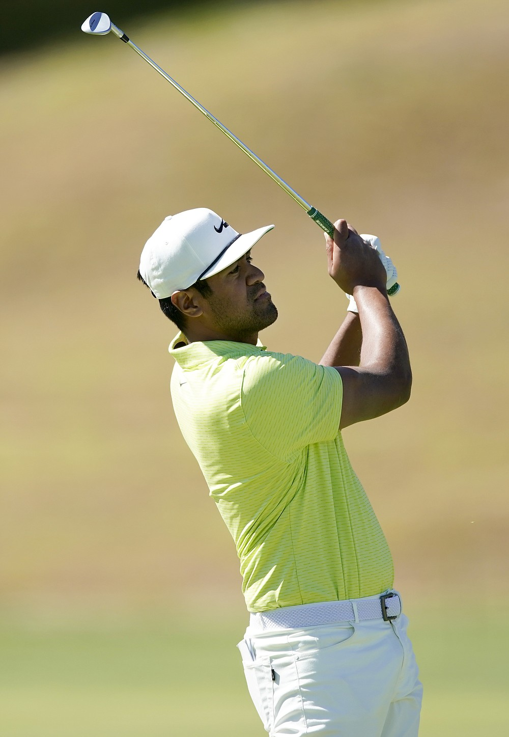 Tony Finau watches his second shot on the ninth hole during the final round of the Genesis Invitational golf tournament at Riviera Country Club, Sunday, Feb. 21, 2021, in the Pacific Palisades area of Los Angeles. (AP Photo/Ryan Kang)