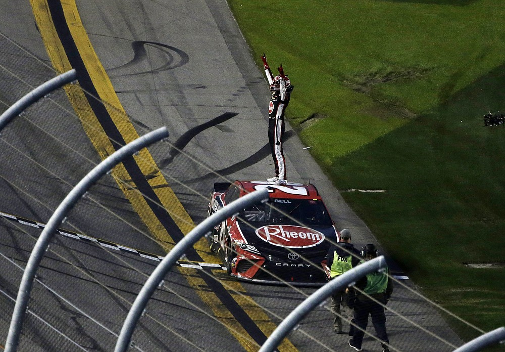 Christopher Bell celebrates at the finish line after winning the NASCAR Cup Series road course auto race at Daytona International Speedway, Sunday, Feb. 21, 2021, in Daytona Beach, Fla. (AP Photo/Terry Renna)