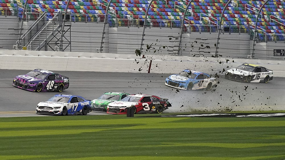 Austin Dillon (3) and Kyle Busch, center left, crash heading down the front stretch as Chris Buescher (17), Alex Bowman (48), Ricky Stenhouse Jr. (47) and AJ Allmendinger (16) make moves to avoid the crash during NASCAR Cup Series road course auto race at Daytona International Speedway, Sunday, Feb. 21, 2021, in Daytona Beach, Fla. (AP Photo/John Raoux)