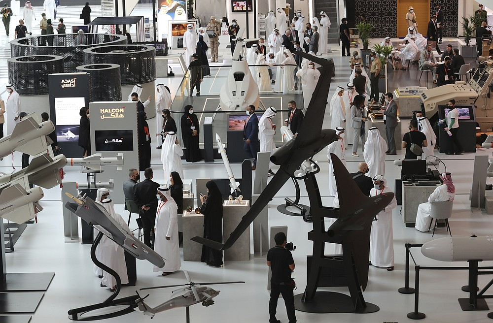 People visit military equipment on display during the opening day of the International Defence Exhibition & Conference, IDEX, in Abu Dhabi, United Arab Emirates, Sunday, Feb. 21, 2021. (AP Photo/Kamran Jebreili)