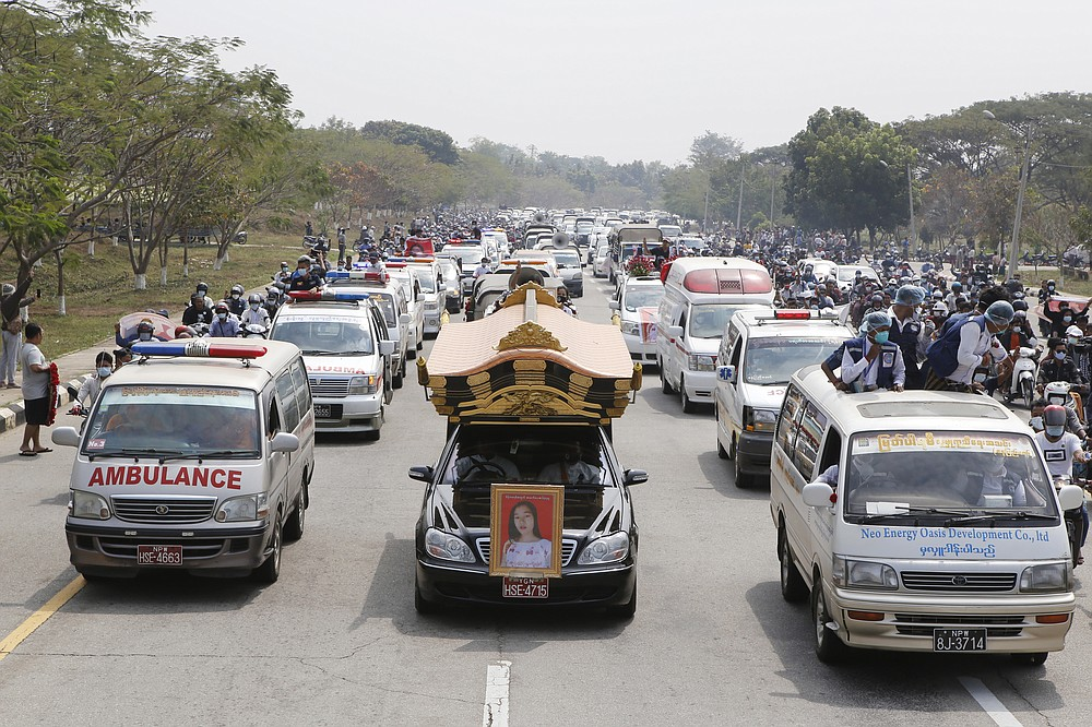 A hearse containing casket of Mya Thwet Thwet Khine travels to the cemetery in Naypyitaw, Myanmar, Sunday, Feb. 21, 2021. Mya Thwet Thwet Khine was the first confirmed death among the many thousands who have taken to the streets to protest the Feb. 1 coup that toppled the elected government of Aung San Suu Kyi. (AP Photo)